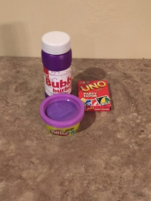 Bubbles, mini Uno cards, and Play-Doh.